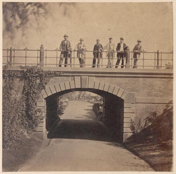 Men standing on Willowdell Arch