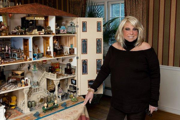 Collector Joanna Fisher with The Fisher Dollhouse