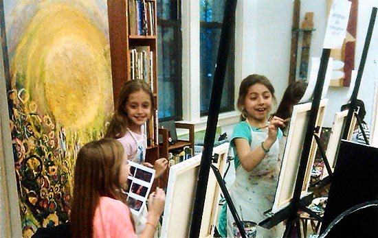 Kids painting on easels in New York City